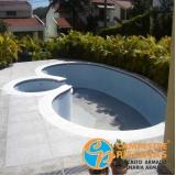 cascata de piscina com pedras Santo Antônio do Jardim