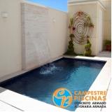 construção de piscina com borda infinita sob medida Jardim Guedala
