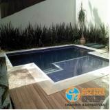 piscina de alvenaria no terraço Casa Branca