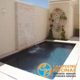 piscina de concreto com cascata preço Estiva Gerbi
