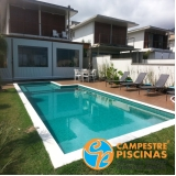 piscina de concreto com deck para sítio Brooklin