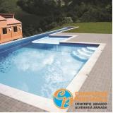 piscinas de concreto com deck para condomínio Charqueada