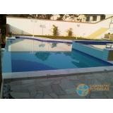 piscinas de concreto com solarium São Lourenço da Serra