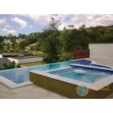 projeto de piscina de concreto com solarium Jardins